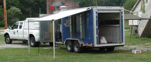 Image of one of the county decontamination trailers hitched to a Sheriff's Emergency Response vehicle.