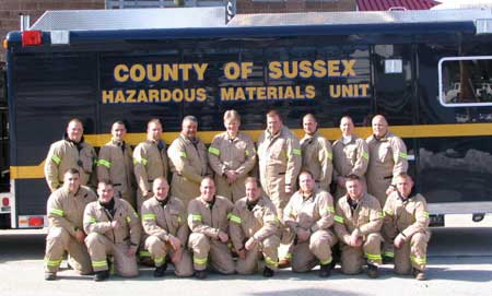 Image of the Sussex County HAZ-MAT team wearing protective Nomex jumpsuits.