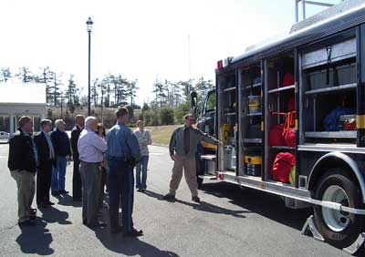 Image of the Sussex County Domestic Preparedness Task Force inspecting HM-1.
