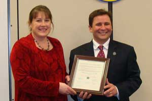 Image of Susan Bowman accepting the Proclamation from Freeholder Richard Zeoli