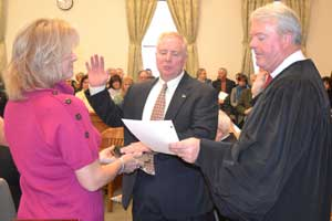 Jeffrey M. Parrot is sworn in as County Clerk by Judge William J. McGovern III.