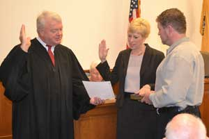 Angela Rosa is sworn in as Deputy County Clerk by Judge William J. McGovern III.