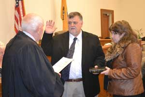 Phillip R. Crabb is sworn in as Freeholder Director by Judge Frederic G. Weber.