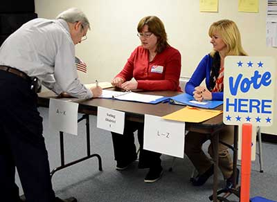 Voter Signing in at polling place