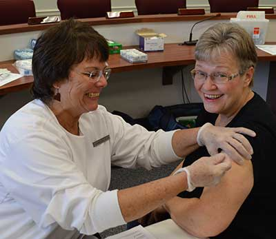Board of Elections Administrator Marge McCabe gets her flu shot
