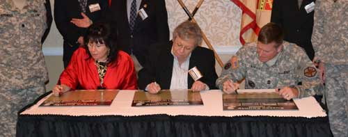 People signing Community Covenant