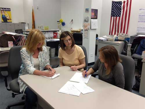 Judy Lynch, Dorleen Donahue, and Ellen Griffiths compose scripts for the videos. Photo: Marge McCabe.
