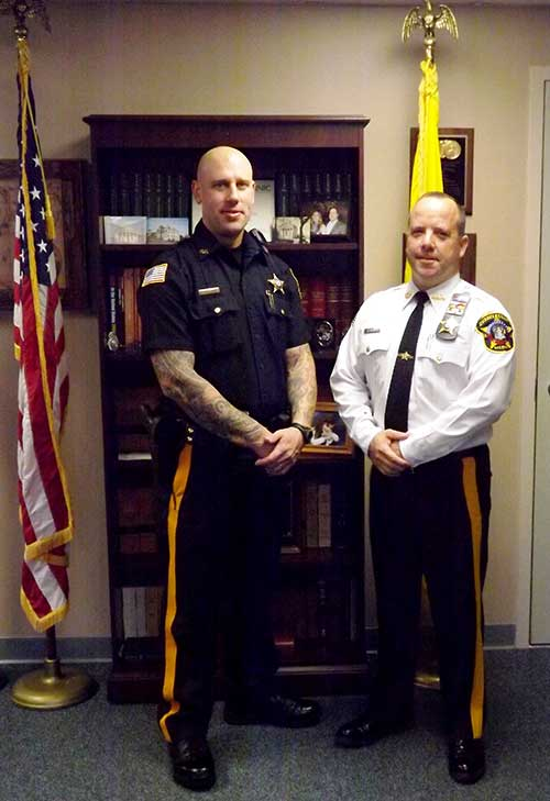Sheriff's Officer Justin McCann and Sheriff Michael F. Strada