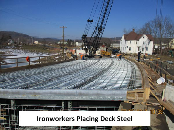 Ironworkers placing deck steel