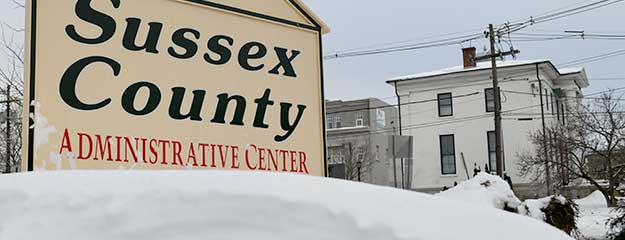 Sussex County sign after snow