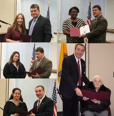 Participants in the Face of Human Services Event receive their certificates from the Board of Chosen Freeholders.